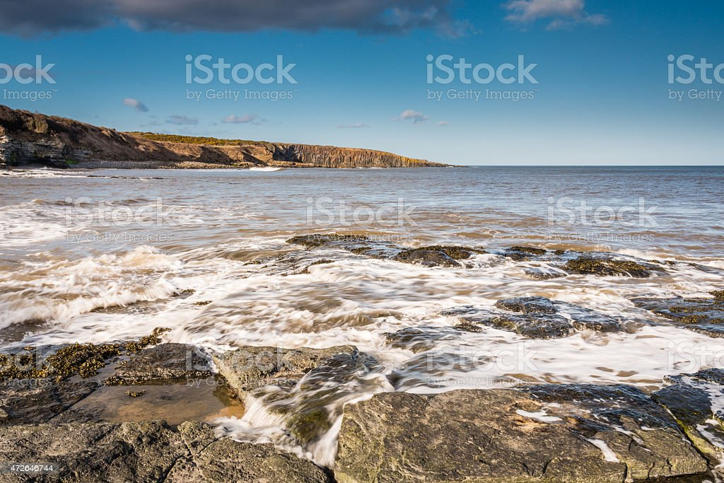 Incoming tide at Cullernose Point stock photo