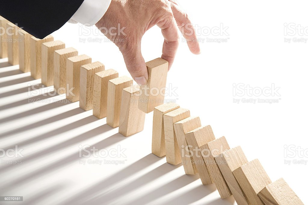 Incomplete falling dominos solution stock photo
