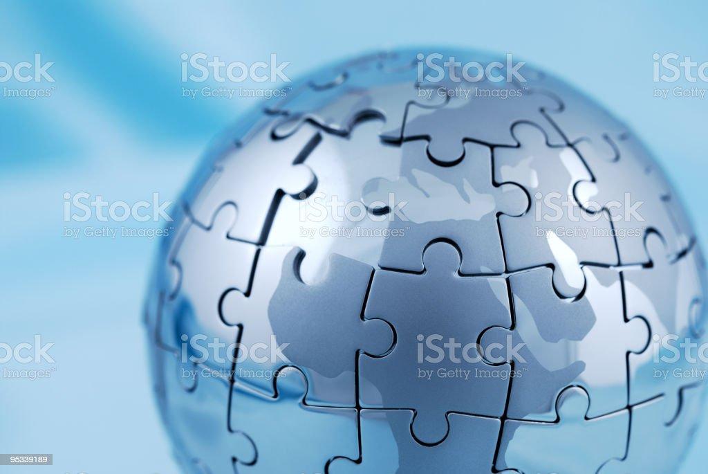 Incomplete globe puzzle stock photo
