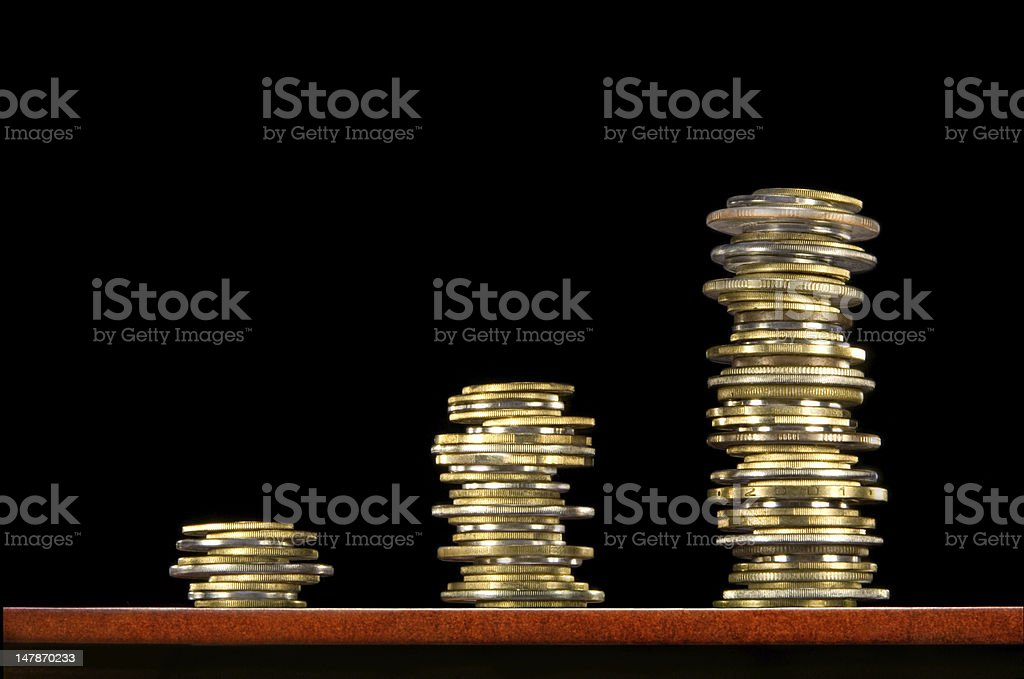 Increase in the profit (fees). Coins, money... royalty-free stock photo