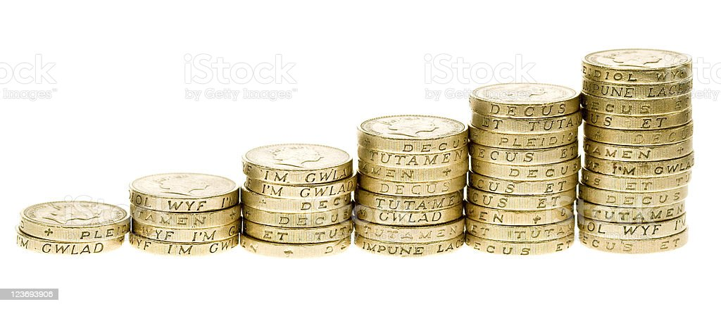 Increasing piles of coins forming a bar graph stock photo