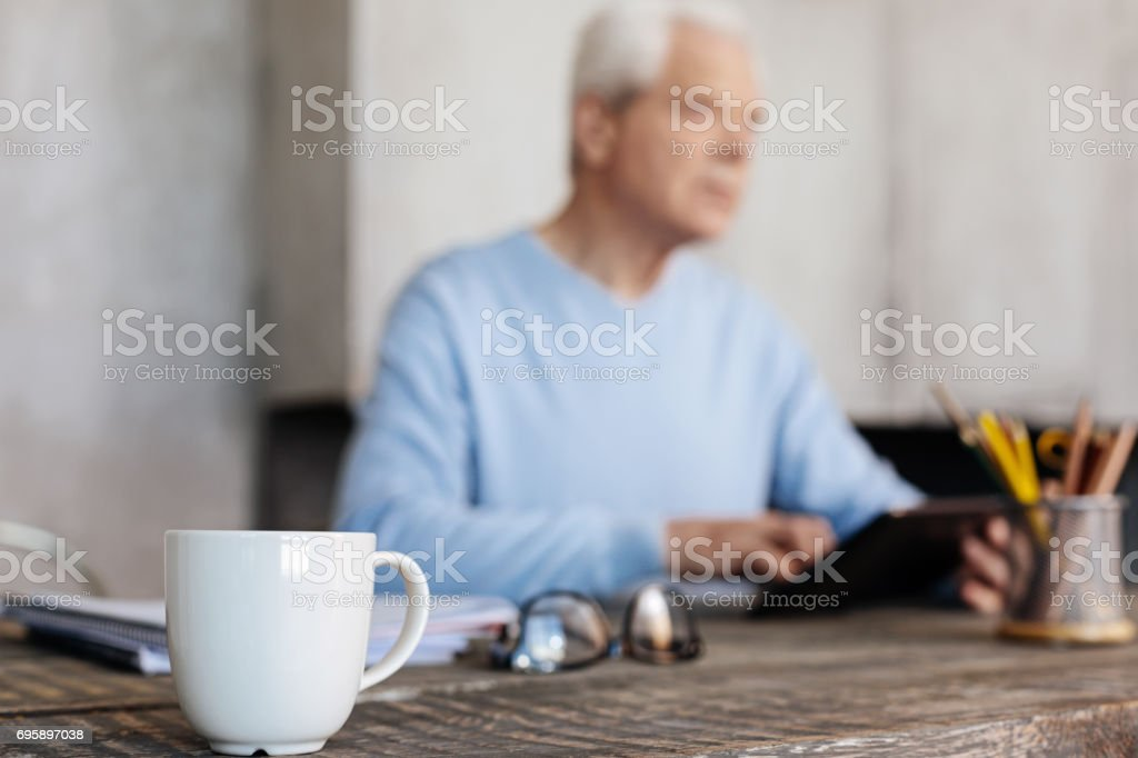 Incredible active gentleman spending time in his home office stock photo