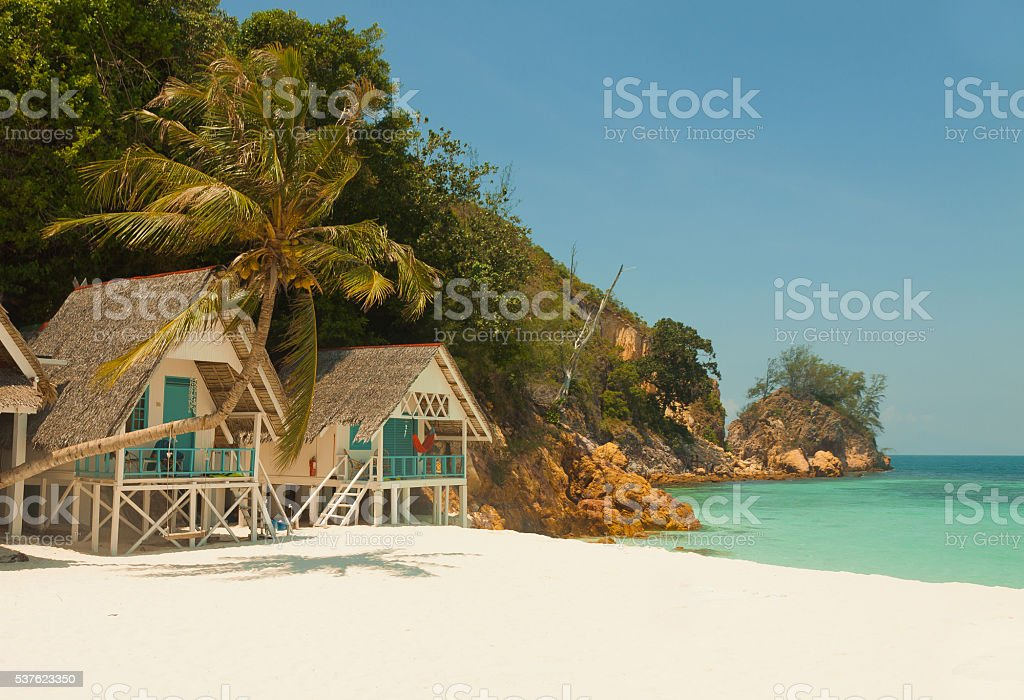 Incredible landscape of little tropical island beach with nice Bungalow stock photo