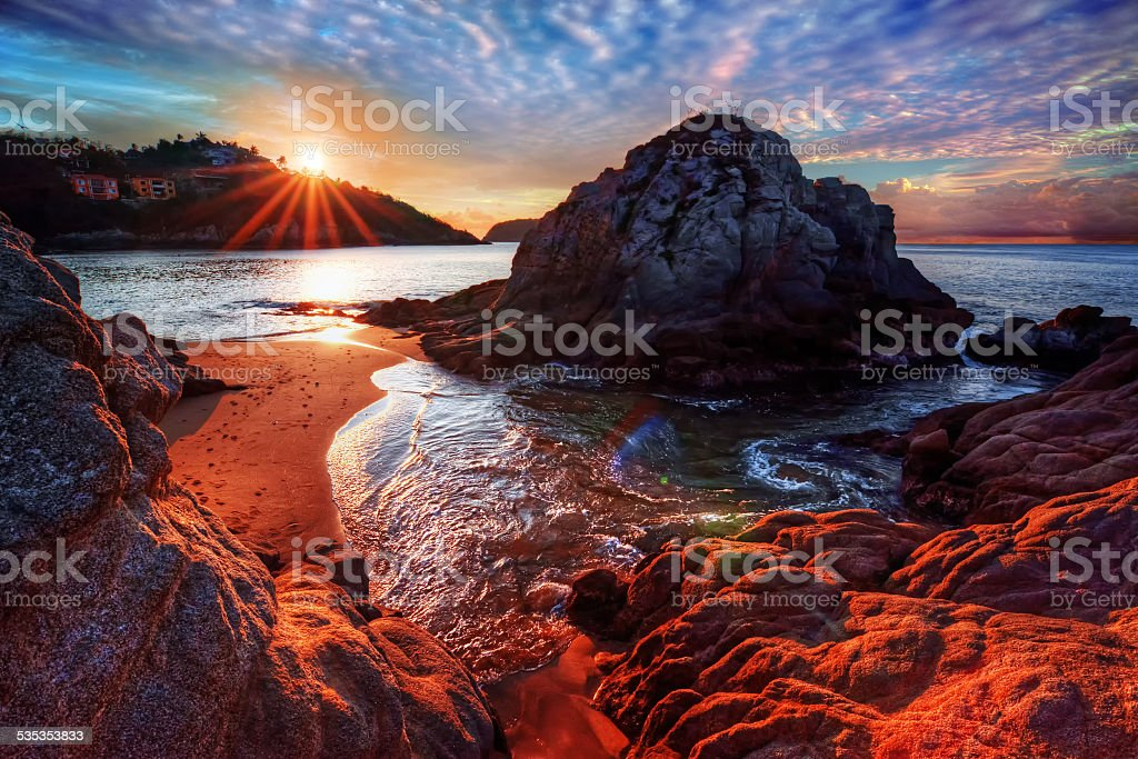 Incredible ocean bay with interesting boulders and rocks stock photo