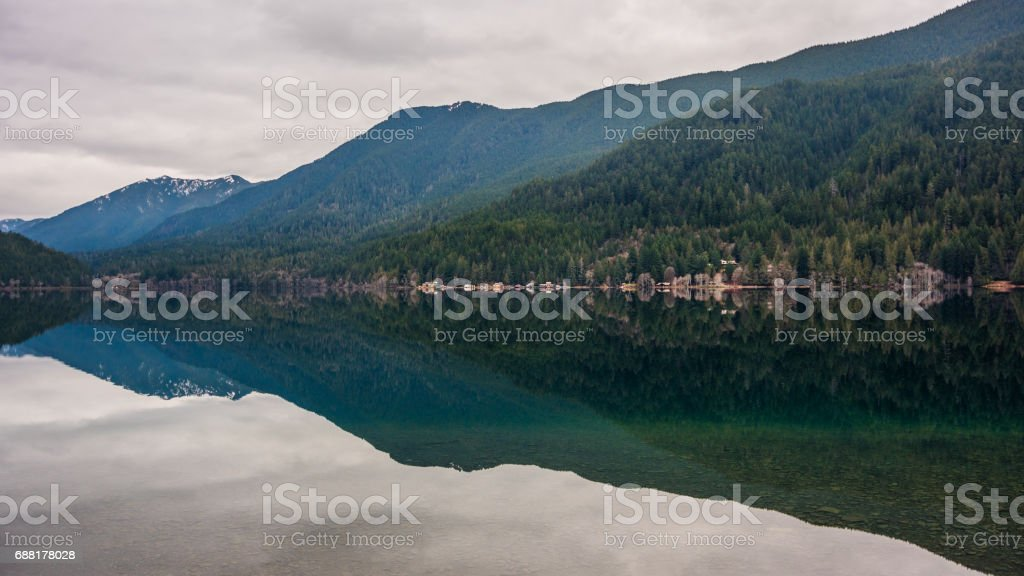 Incredible reflection of the forest and mountains in the huge lake. stock photo