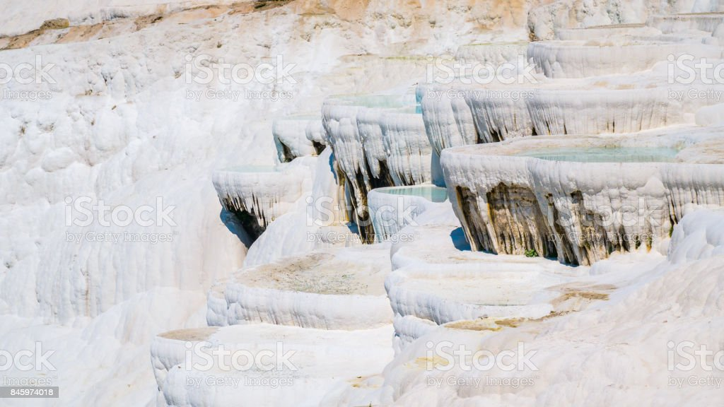 Incredible surface of the shimmering, snow-white limestone, shaped over millennia by calcium-rich springs. stock photo