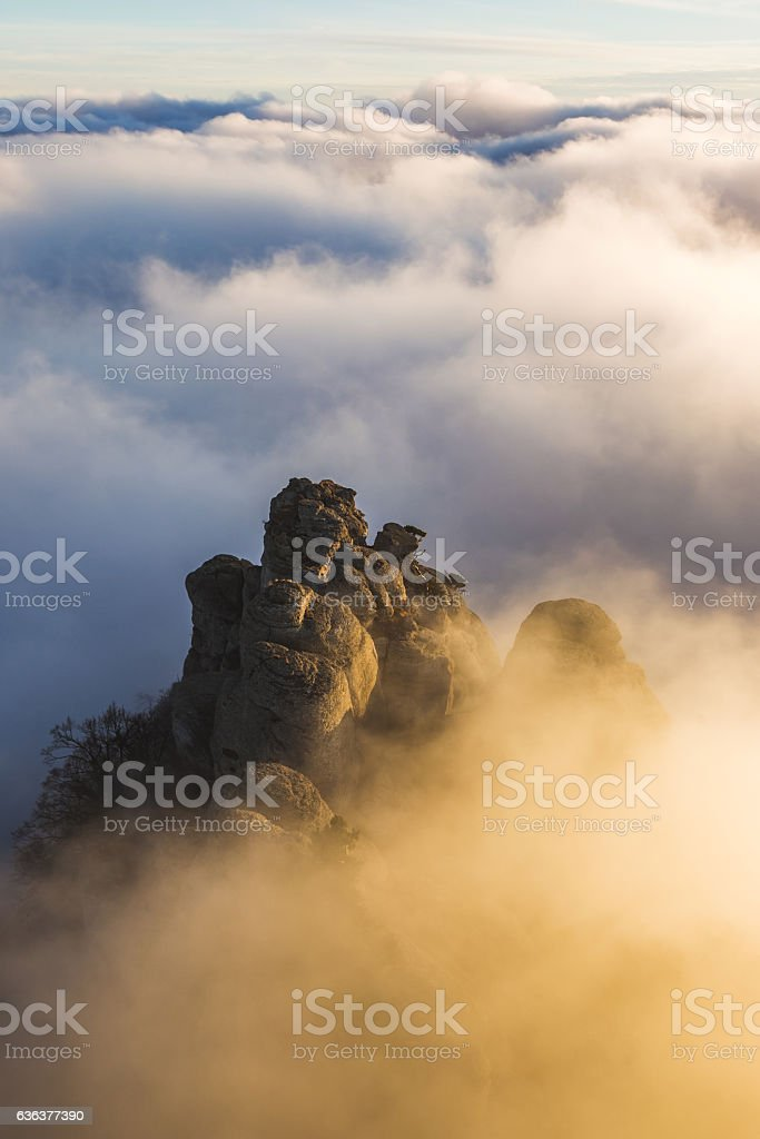 Incredible view of top mountain in clouds at sunset stock photo