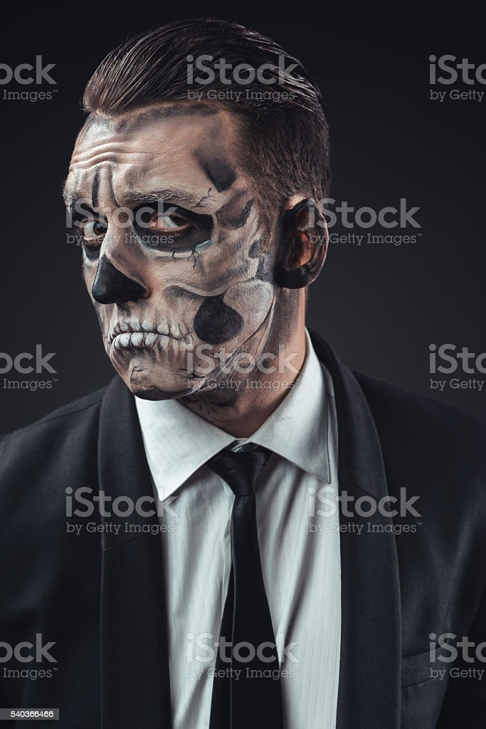 incredulous businessman with makeup skeleton stock photo