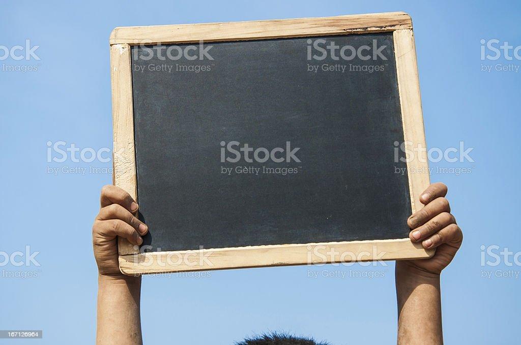Indan cute boy holding slate stock photo