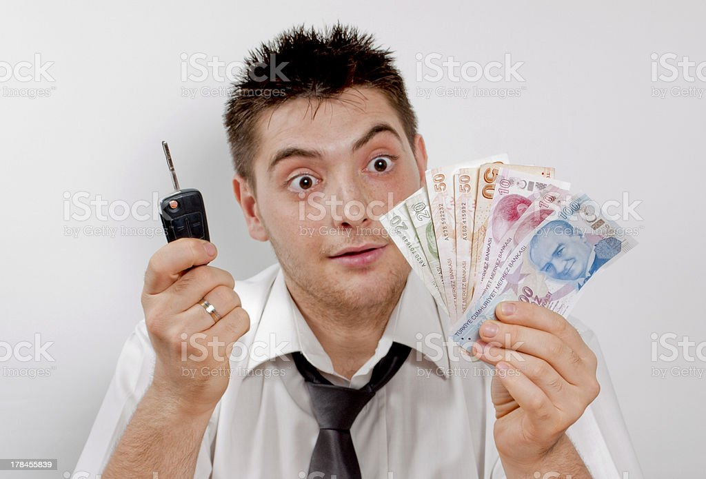 Indecisive And Bewildered Man Thinking About Money stock photo