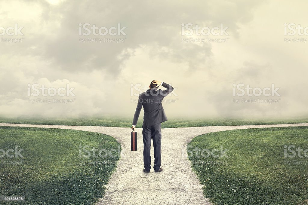 indecisive and lost man chooses the right path stock photo
