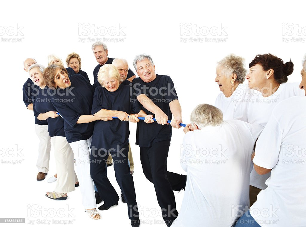 Indecisive doubtful old people pulling rope royalty-free stock photo