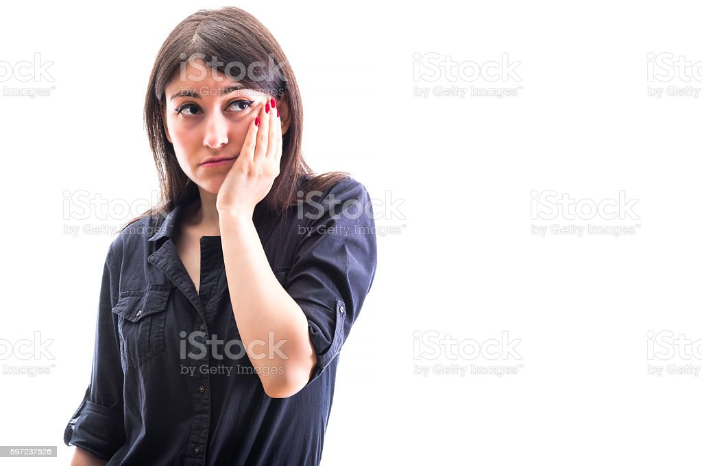 Indecisive girl holding her cheek stock photo