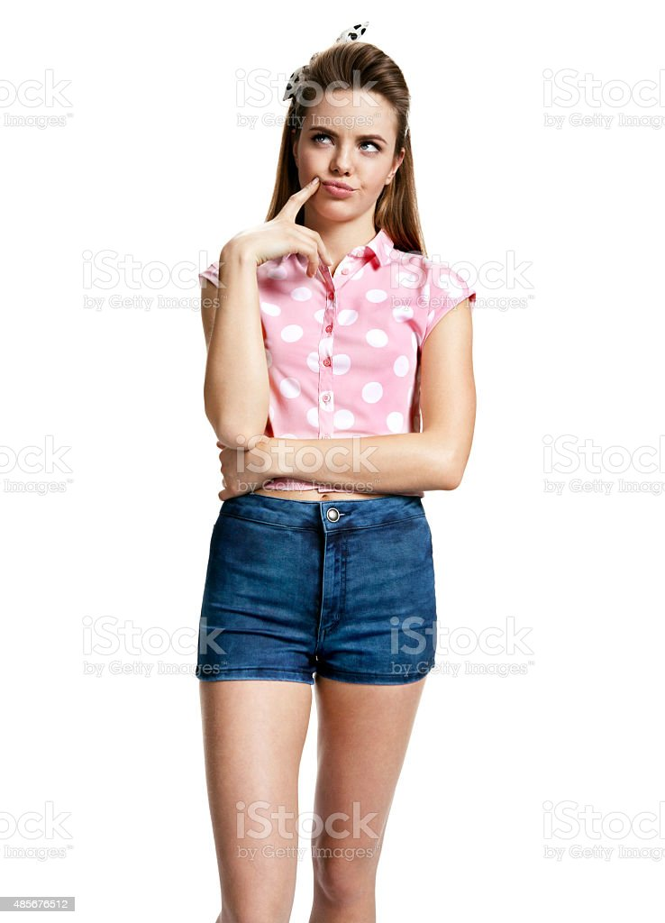 Indecisive girl thinking and looking towards stock photo