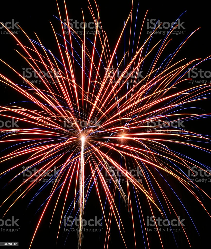 Independence Day Colorful Streaking Twin Fireworks Explosions stock photo