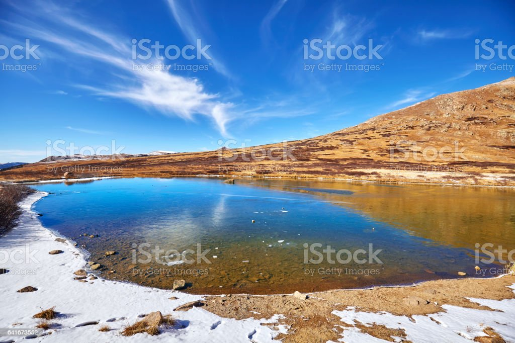 Independence Pass mountain landscape with lake and blue sky. stock photo