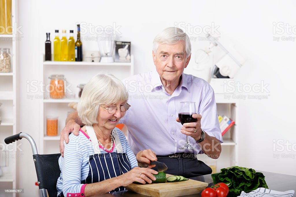 Independent Handicapped Senior Woman and Partner Preparing Healthy Meal royalty-free stock photo