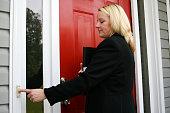 Independent saleswoman ringing doorbell