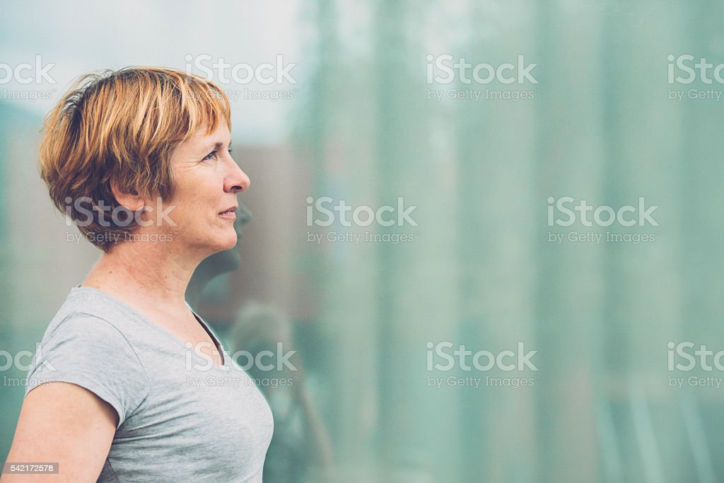 Independent Senior woman portrait - looking away, front view stock photo