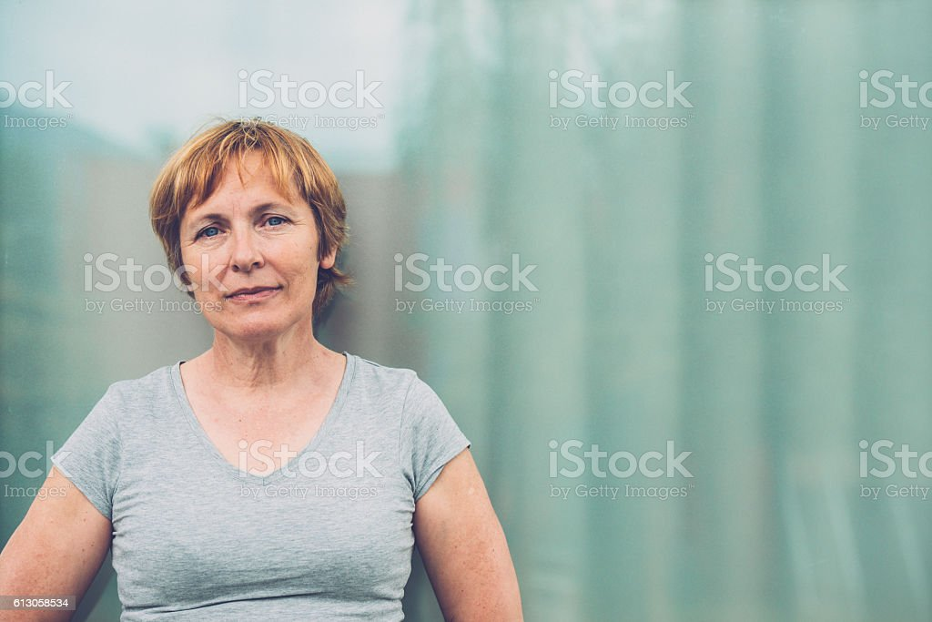 Independent Senior woman with short hair portrait outdoors stock photo