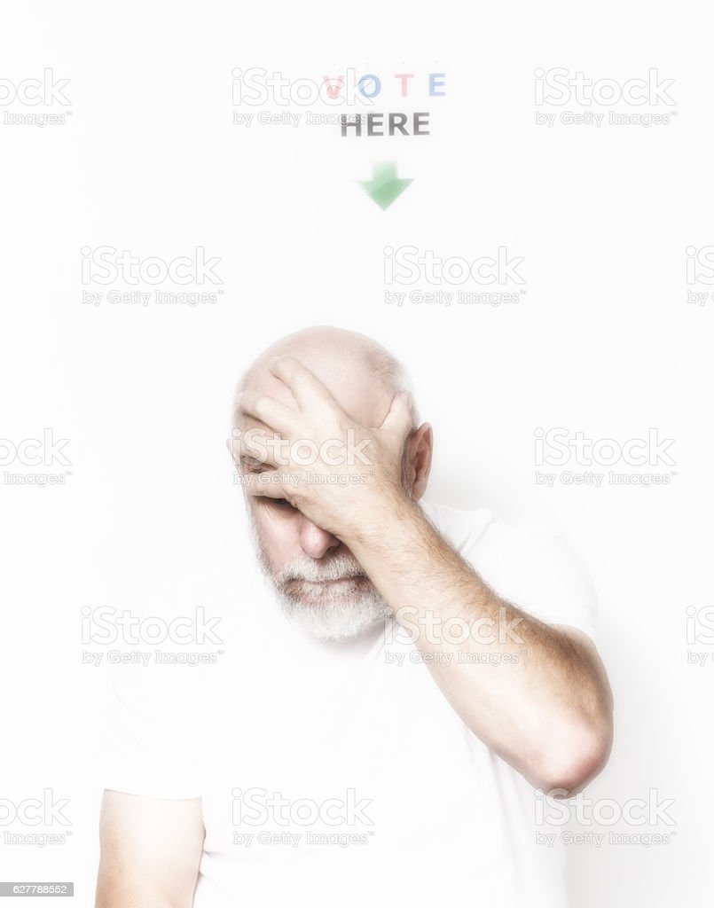 Independent USA Senior Man Voter Holding Head With Hand stock photo