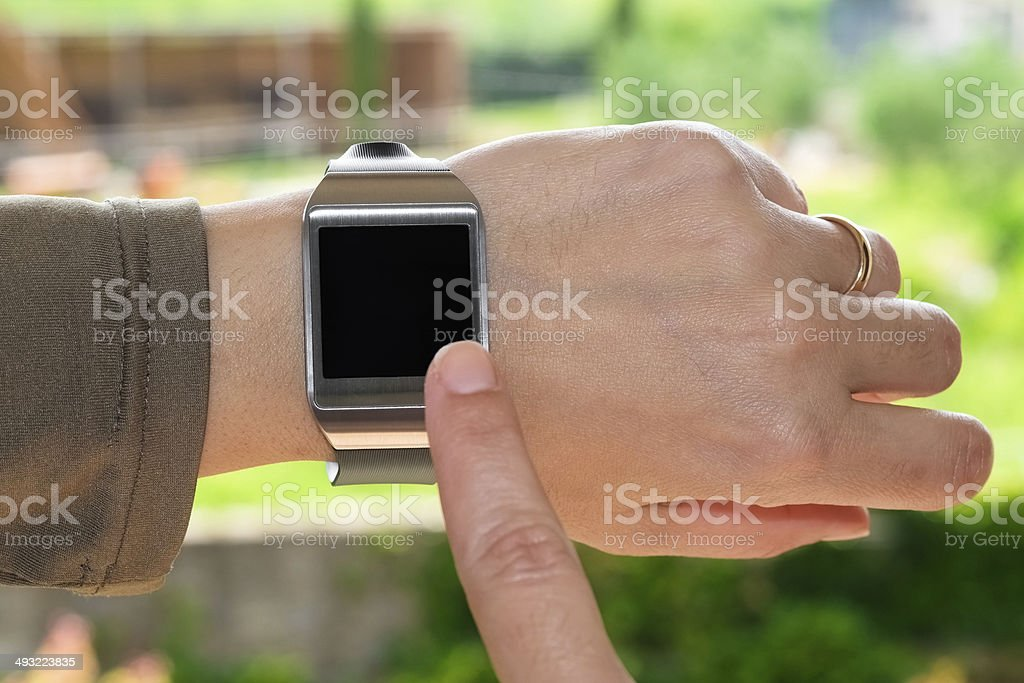 Index finger on smartwatch stock photo