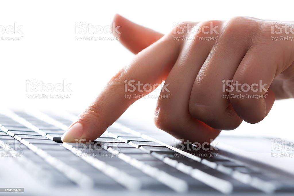 Index finger pressing key on keyboard stock photo