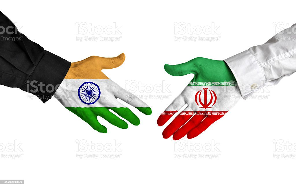 India and Iran leaders shaking hands on a deal agreement stock photo