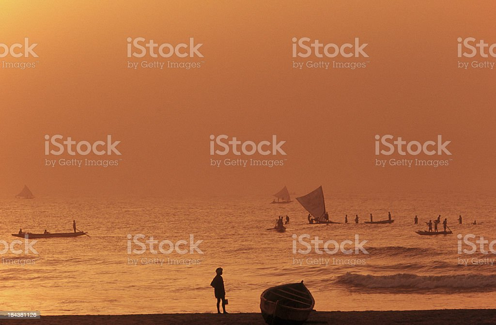 India, Andra Pradesh, fishermen at sunrise, Bay of Bengal. stock photo