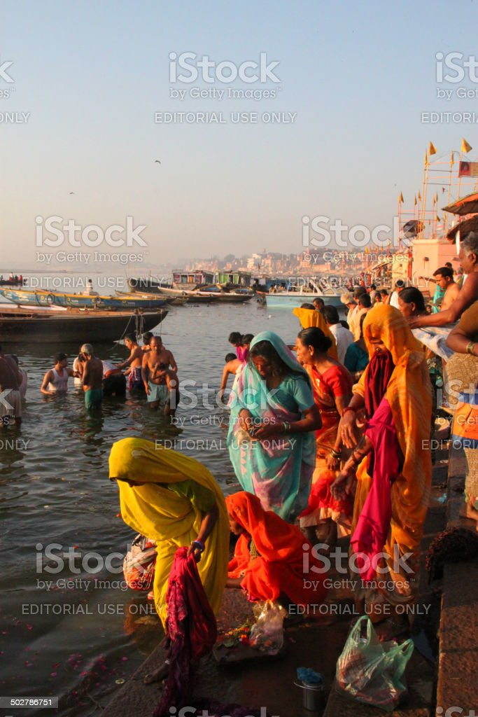 India: Bathing in the Ganges River at Sunrise in Varanasi stock photo