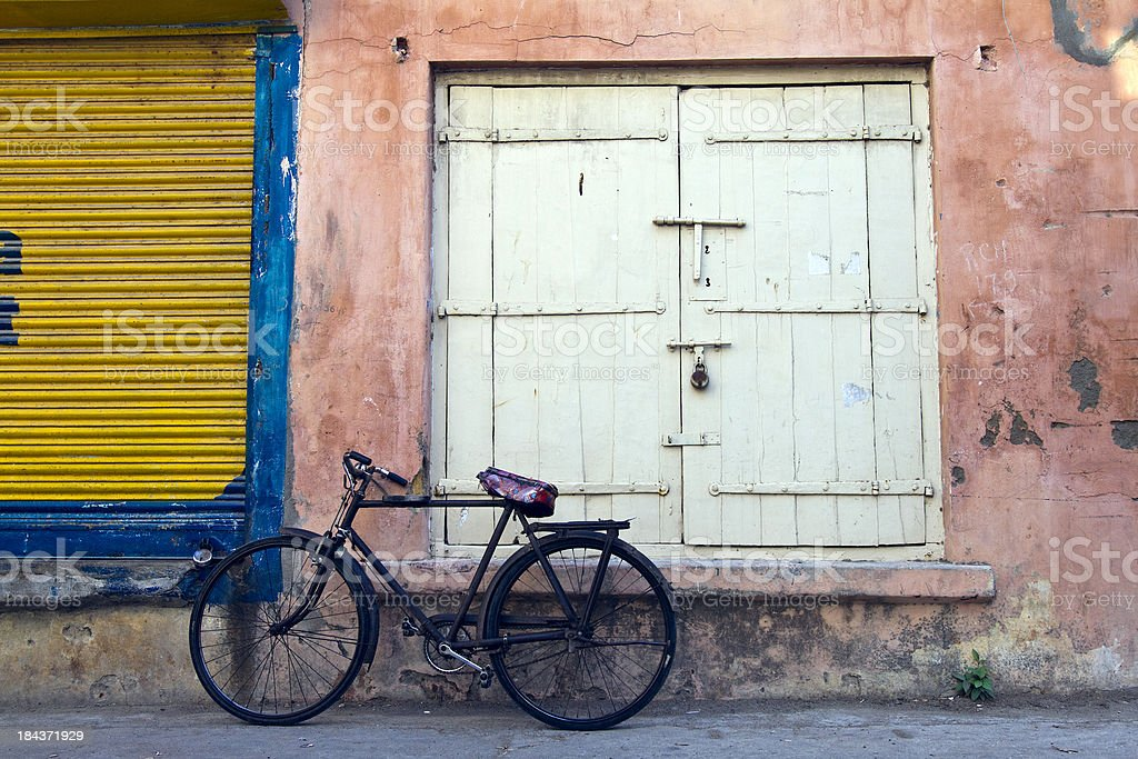 India, Diu, bicycle in alleyway. stock photo