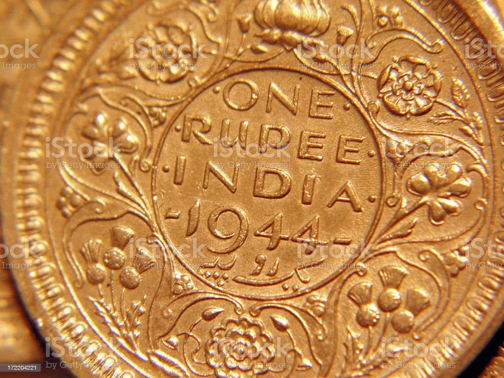 India One Rupee Silver Coin 1944 with gold tone. royalty-free stock photo