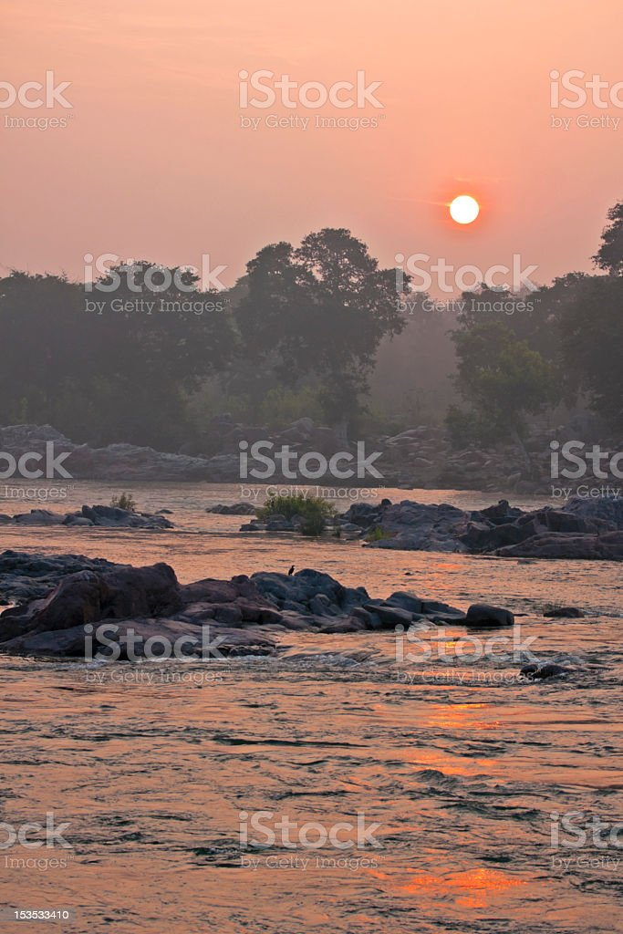 India, Orchha: Early morning rising over jungle colors skies. royalty-free stock photo