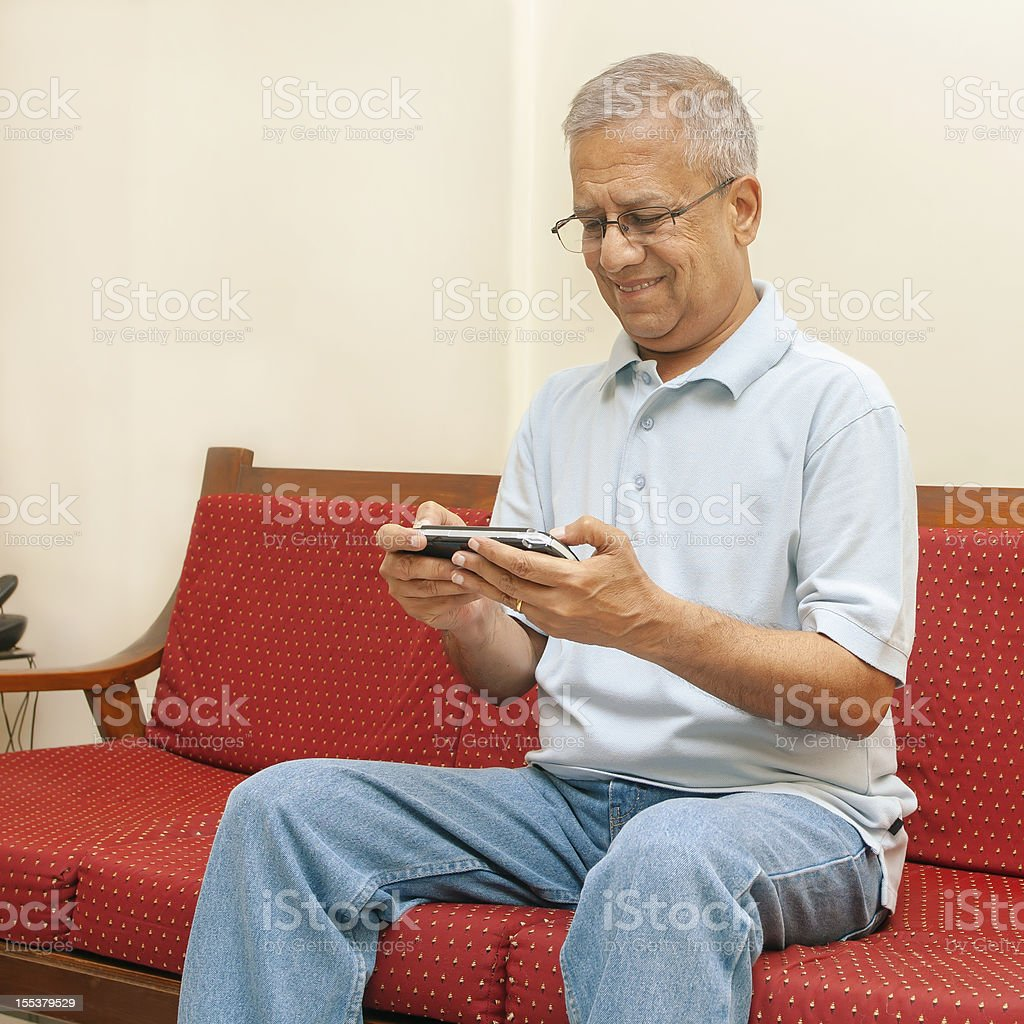 Indian adult playing game stock photo