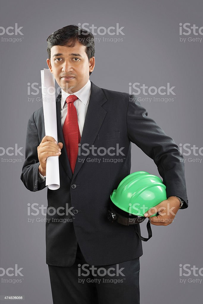 Indian architect  with blue print stock photo