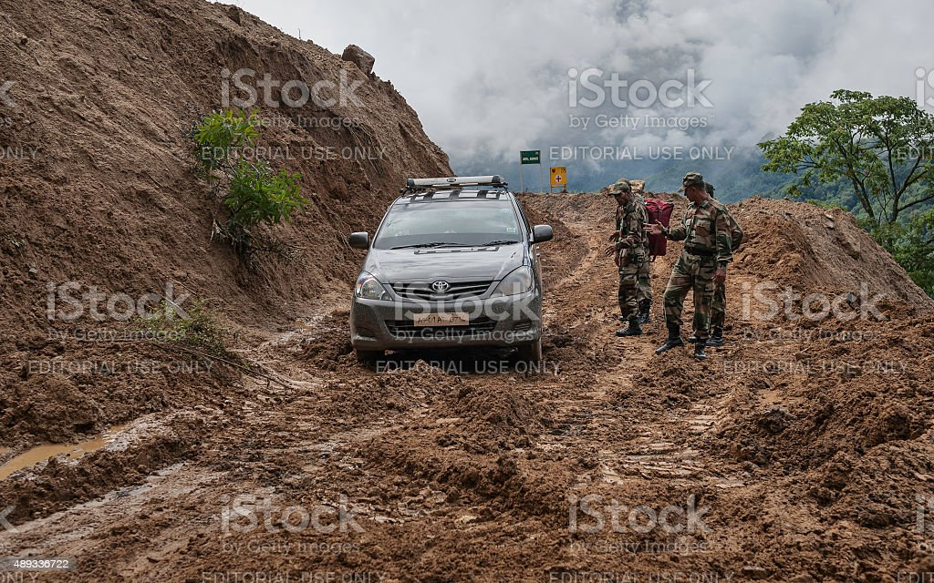 Indian army rescue car from mud slide, Arunachal Pradesh, India. stock photo