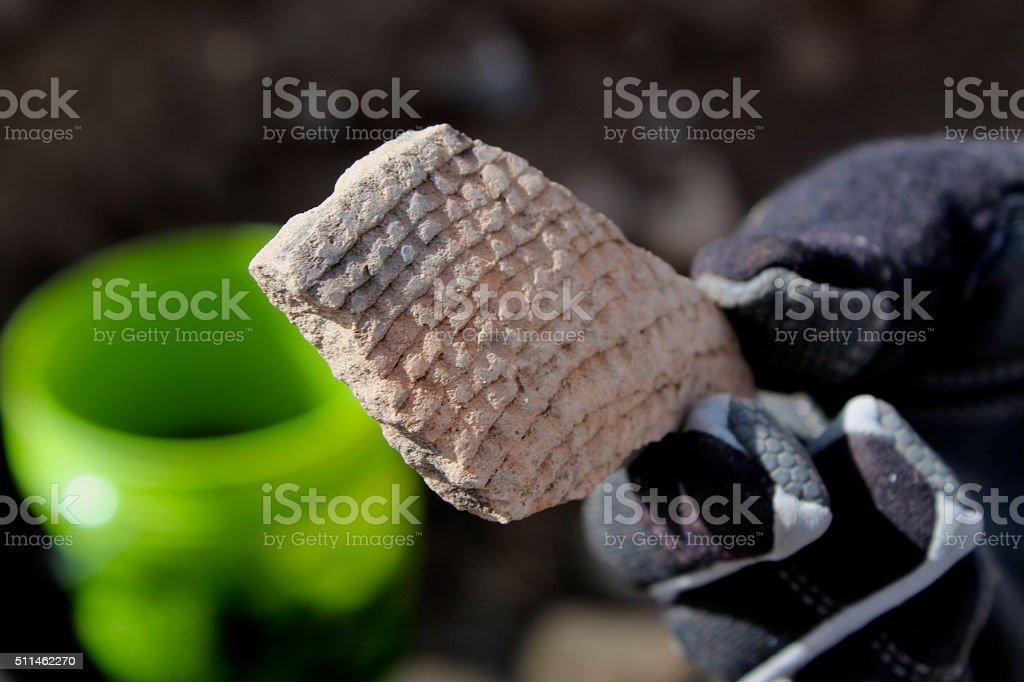 Indian Artifact - shard of pottery stock photo