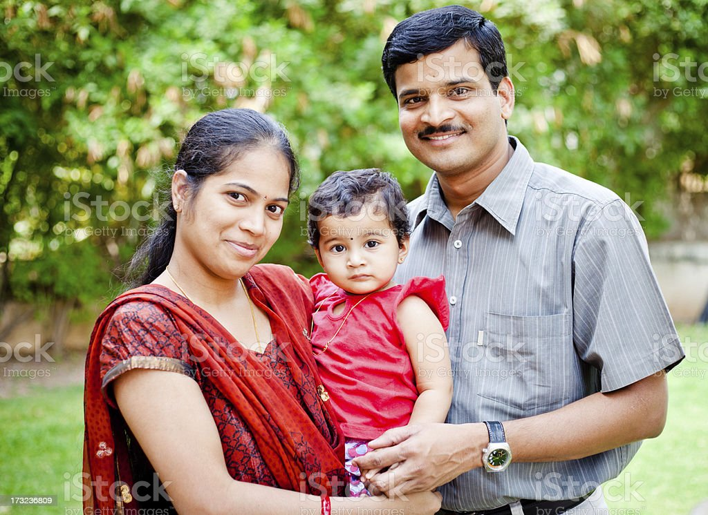 Indian Asian family with one child stock photo