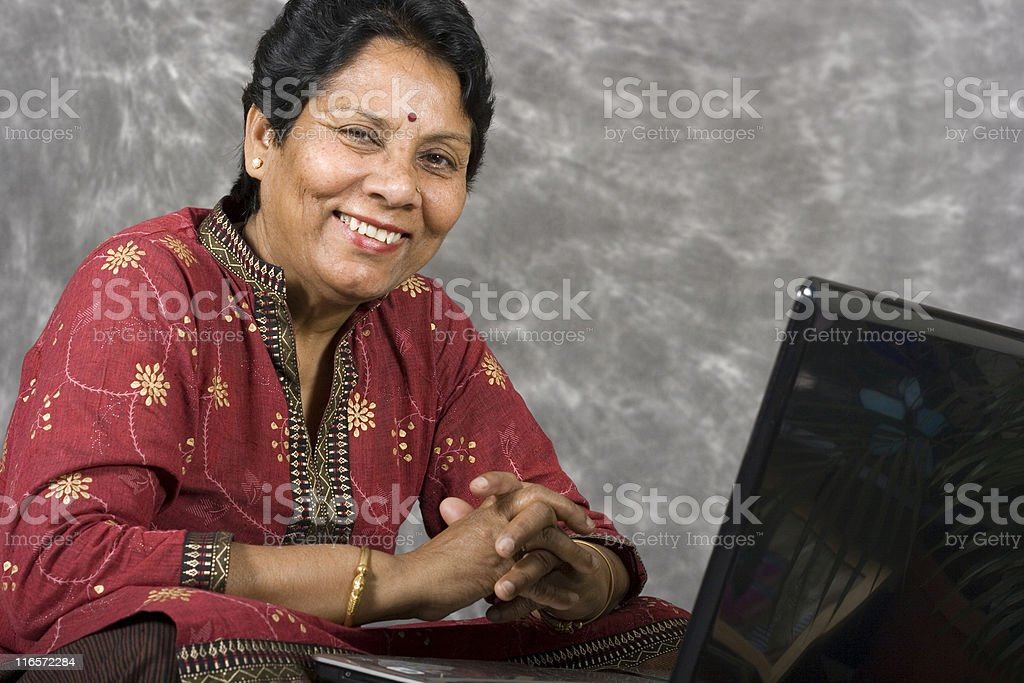 Indian asian senior lady woman female with laptop royalty-free stock photo