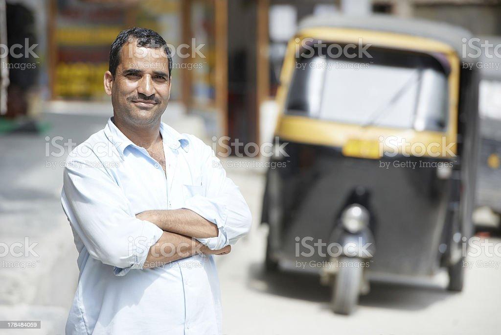 Indian auto rickshaw tut-tuk driver man royalty-free stock photo