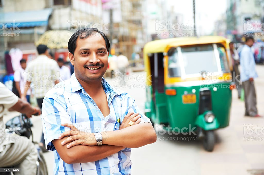 Indian auto rickshaw tut-tuk driver man stock photo