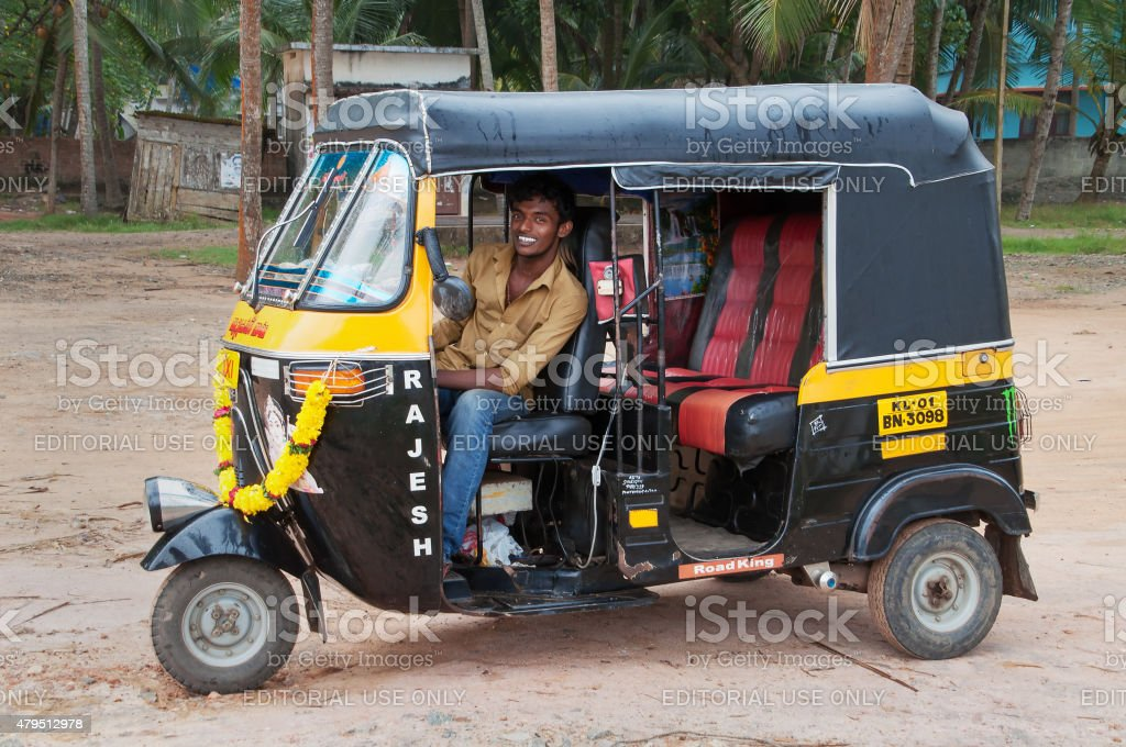 Indian auto rickshaw with taxi driver man stock photo