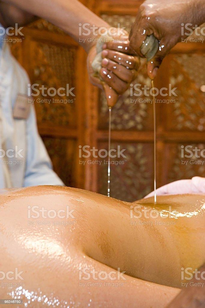 indian ayurvedic oil body massage royalty-free stock photo