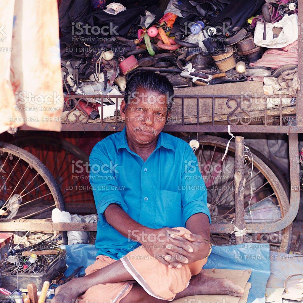 Indian bicycle repairman royalty-free stock photo