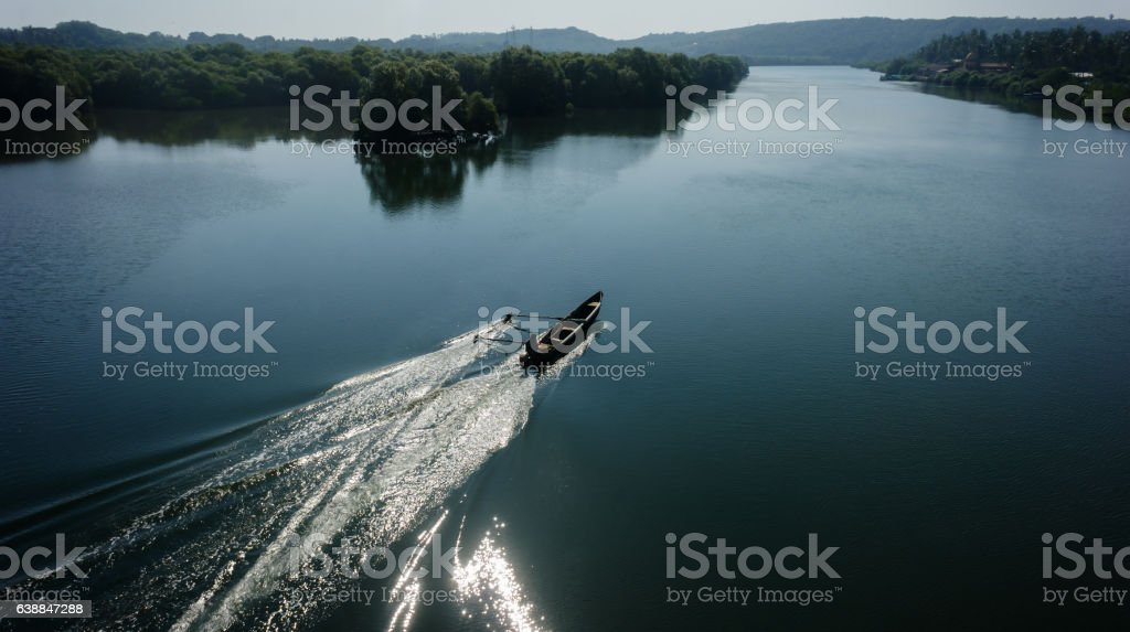 Indian boatman driving lake trace stock photo