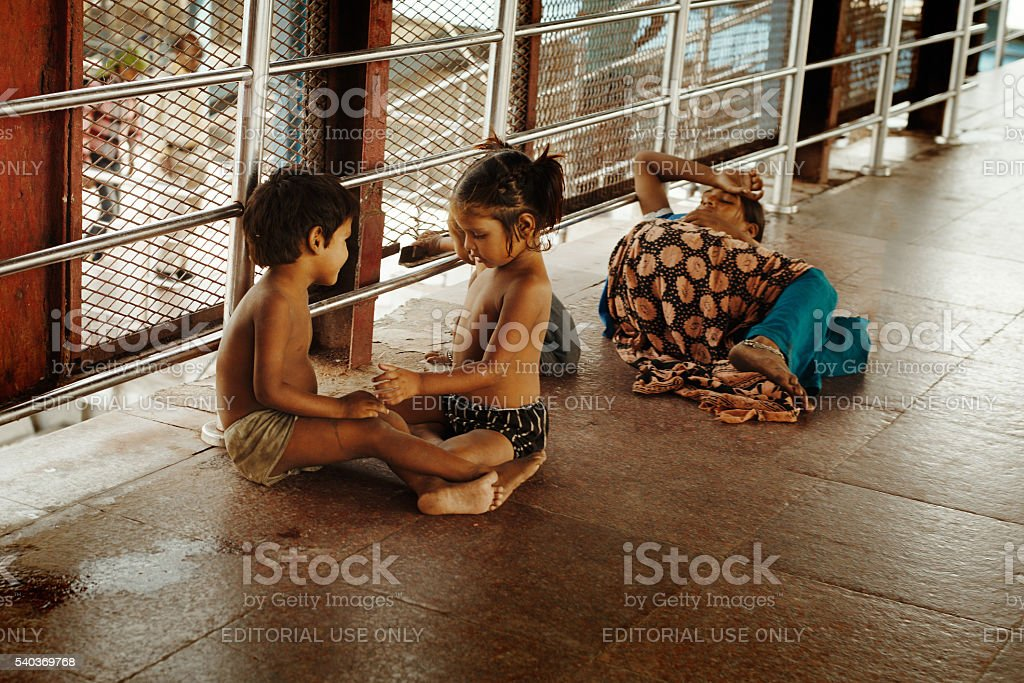 Indian boy and girl playing at the railway station stock photo