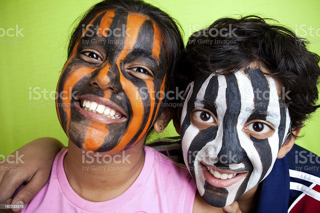 Indian Boy and Girl wearing Zebra Tiger Strips face painting royalty-free stock photo