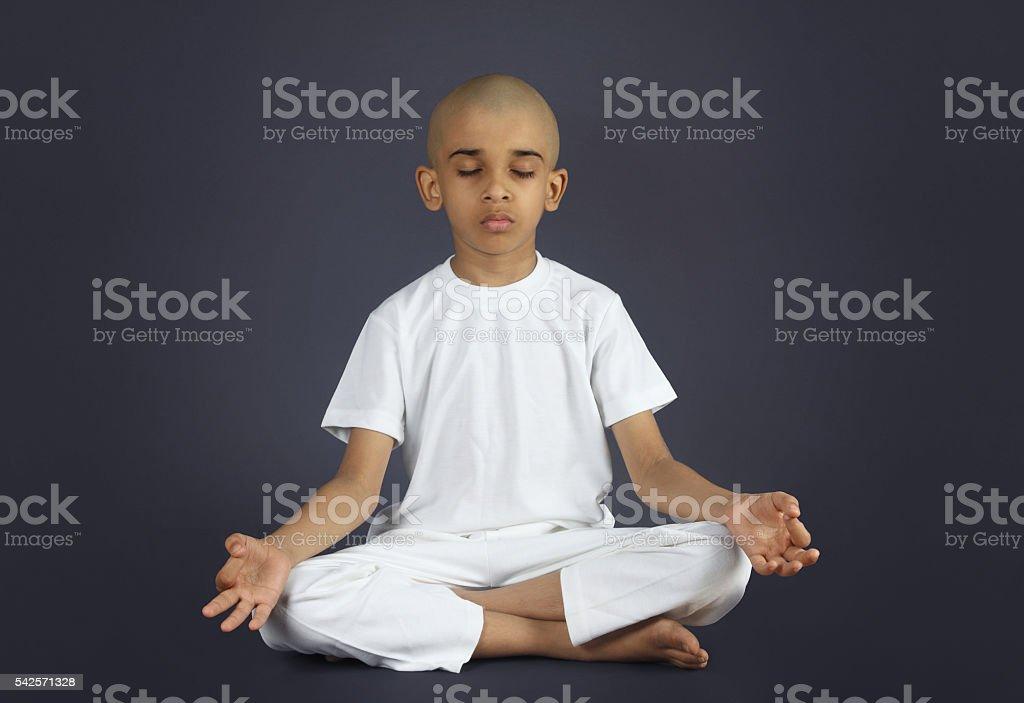 Indian Boy Doing Meditation stock photo