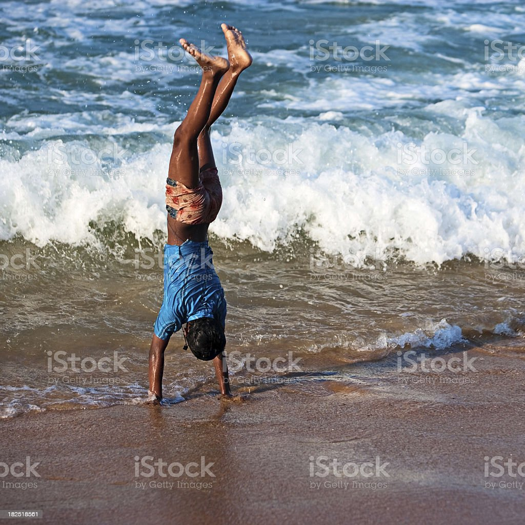 Indian boy having fun on the beach royalty-free stock photo