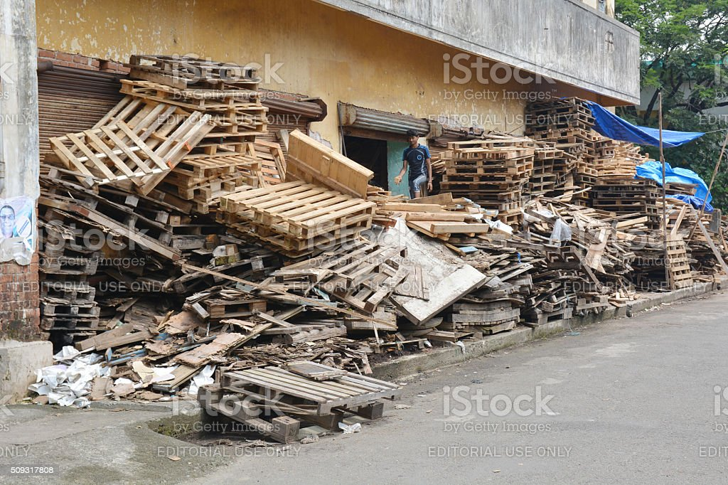 Indian boy recycling pallets stock photo